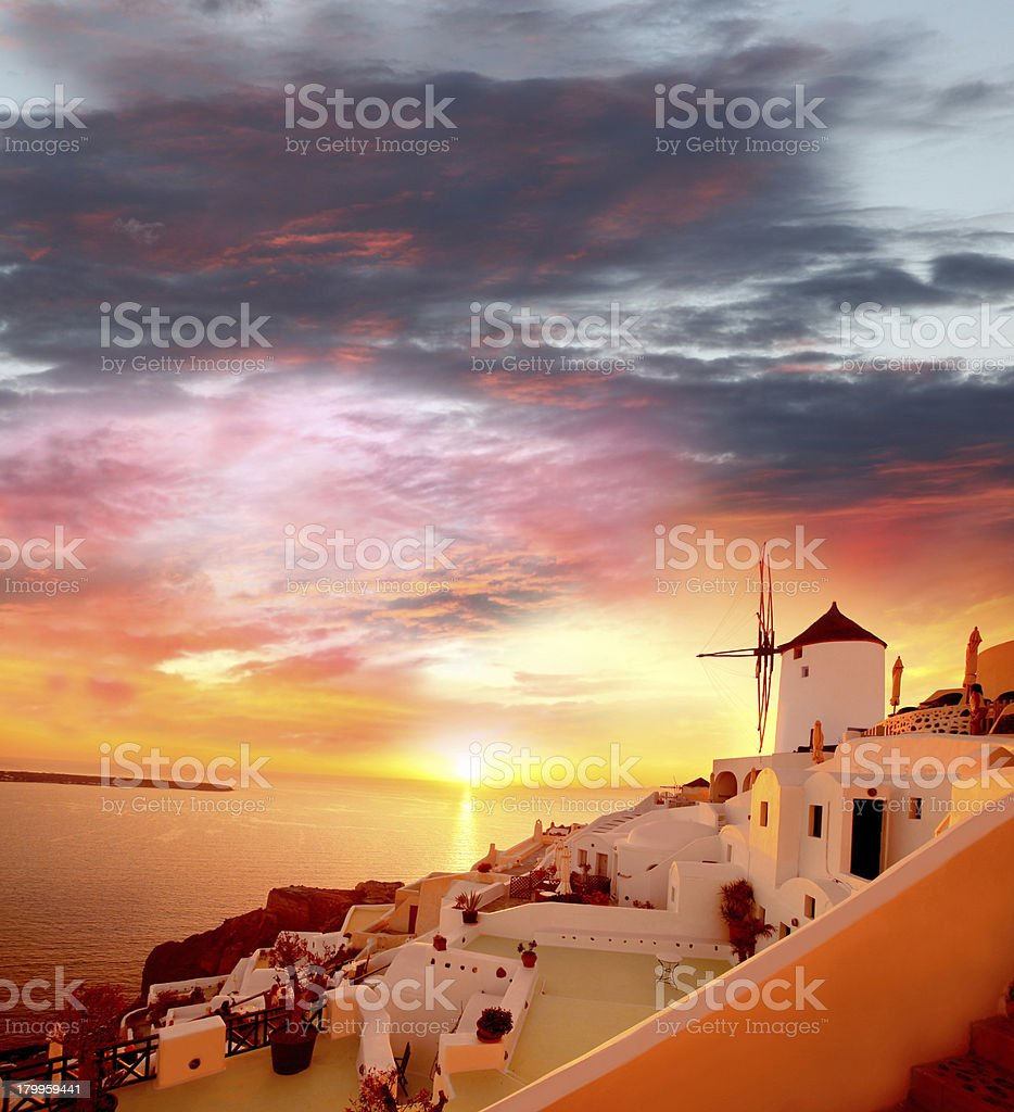 Windmill against colorful sunset in  Santorini, Greece royalty-free stock photo