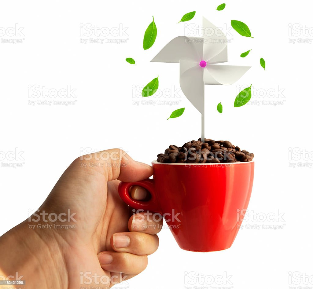 windmill and coffee beans in red cup stock photo