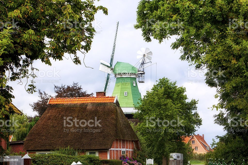 Windmill and Cottage at Altes Land village stock photo
