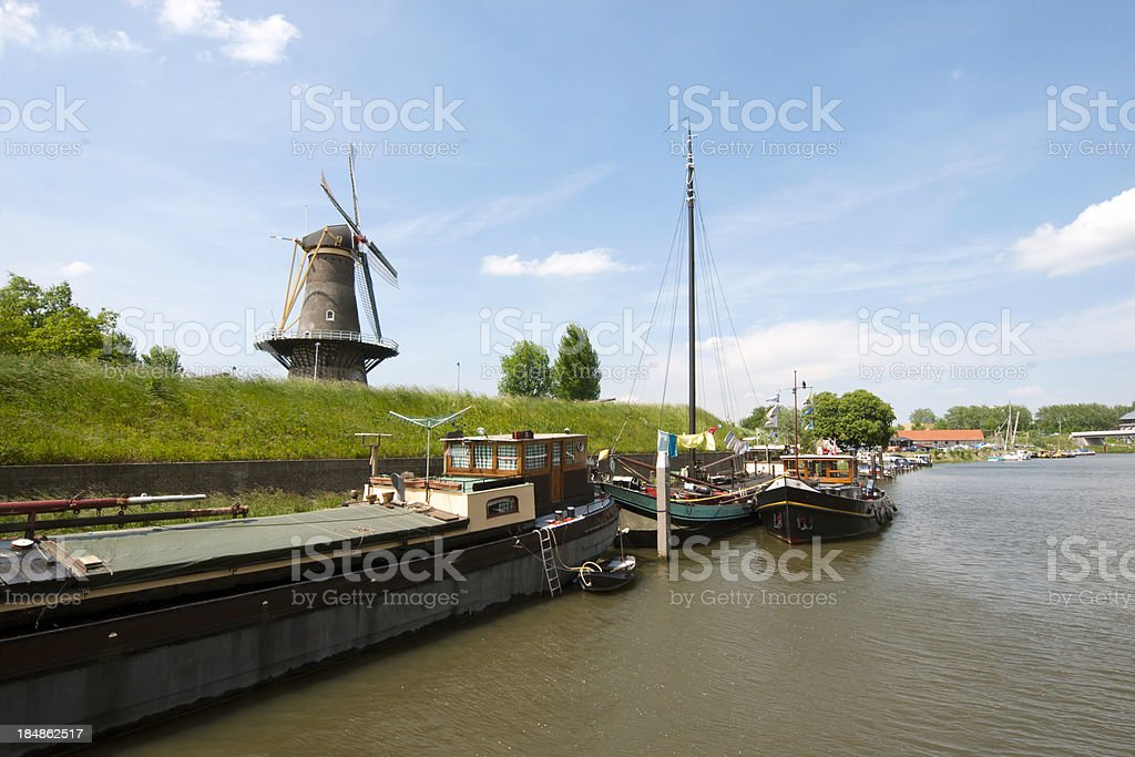 Windmill and houseboats in the Netherlands stock photo