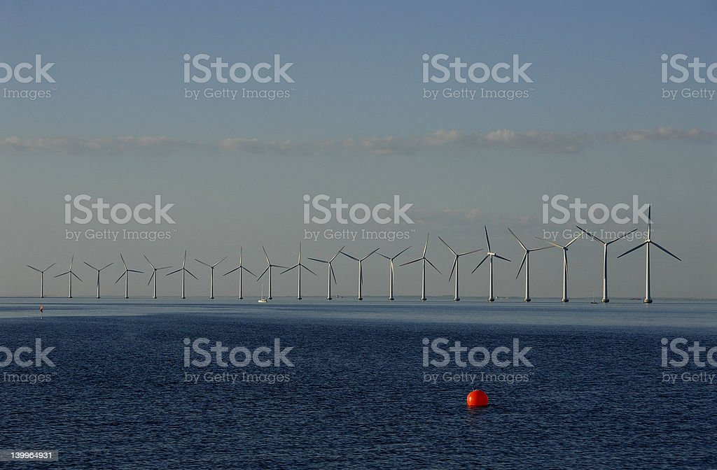 Windmill and red bouy stock photo