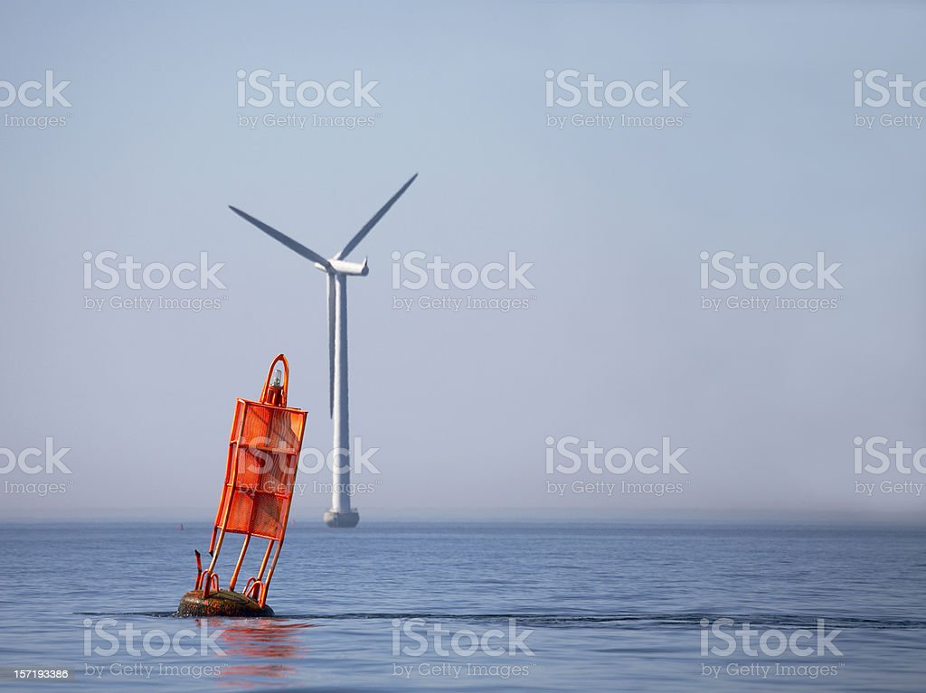 Windmill and red buoy royalty-free stock photo