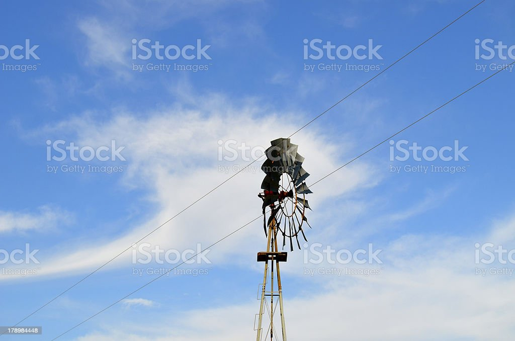 Windmill and wires royalty-free stock photo