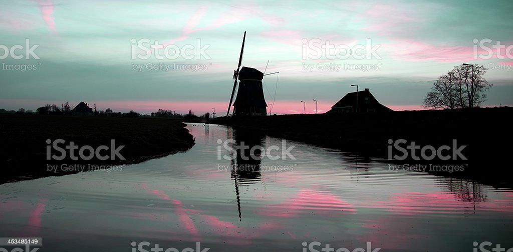 Windmill at sunrise royalty-free stock photo