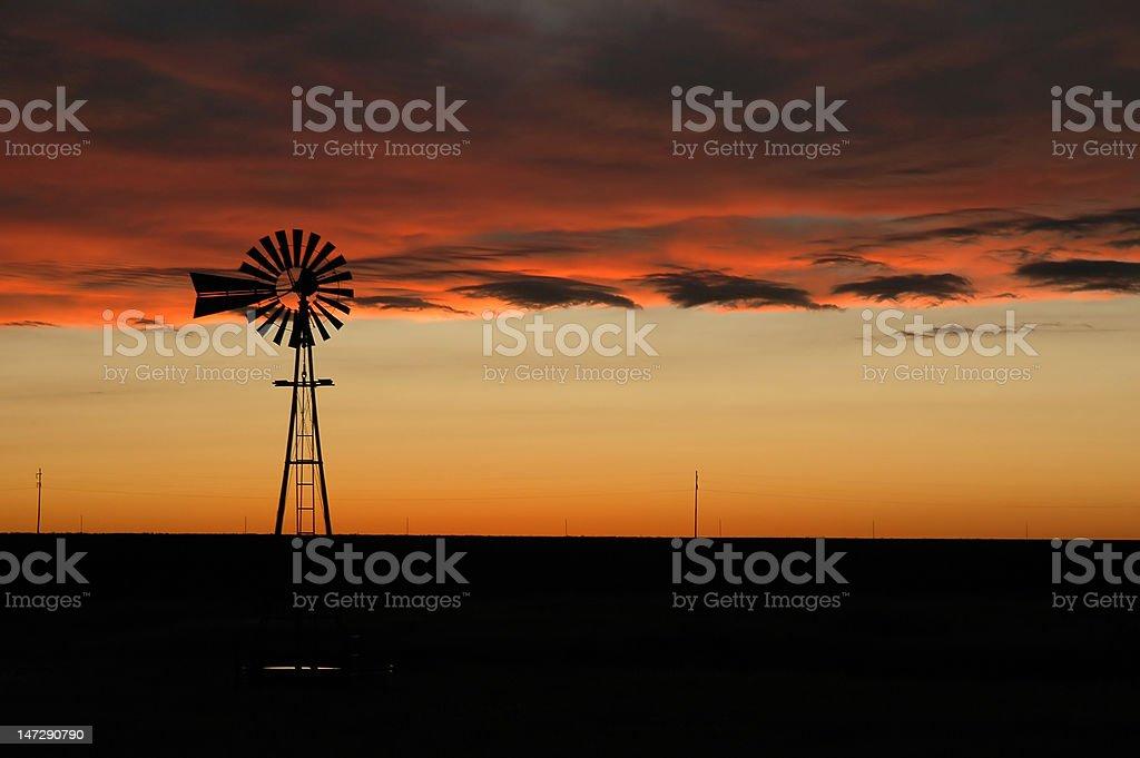 Windmill at Sunset in Oklahoma stock photo