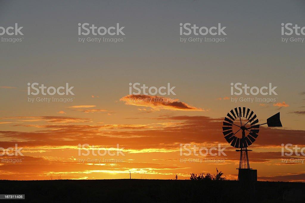 Windmill at sunset royalty-free stock photo