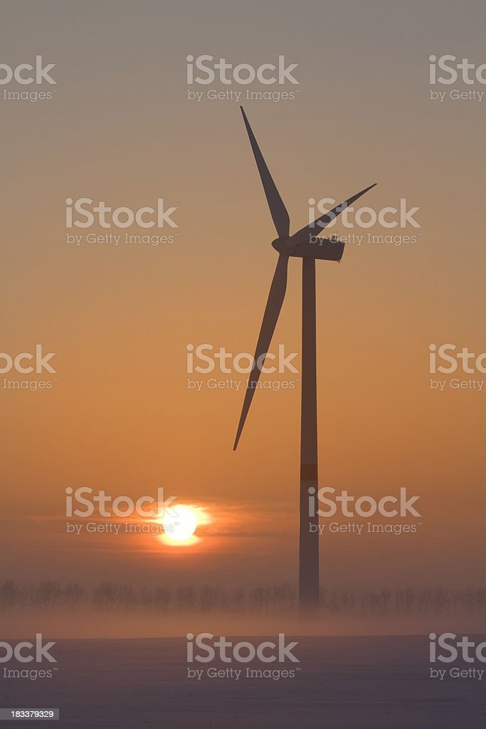 Windmill at the sunset stock photo