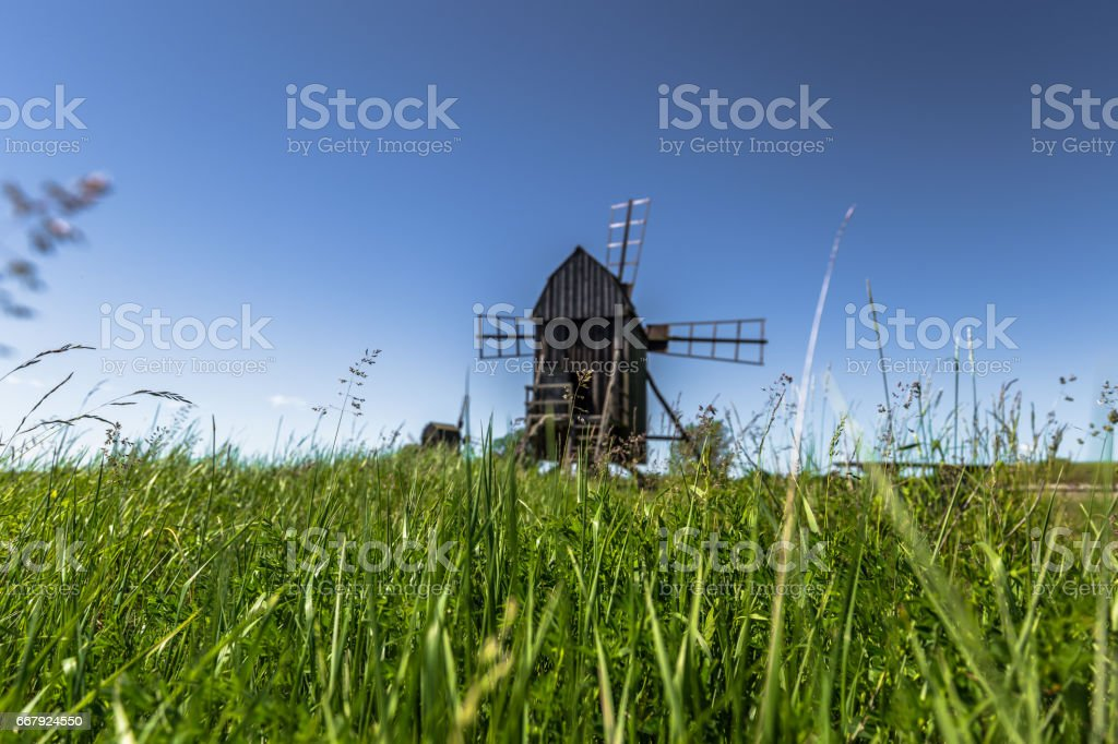 Öland, Sweden - June 05, 2016: Windmill by the grass, Öland, Sweden stock photo