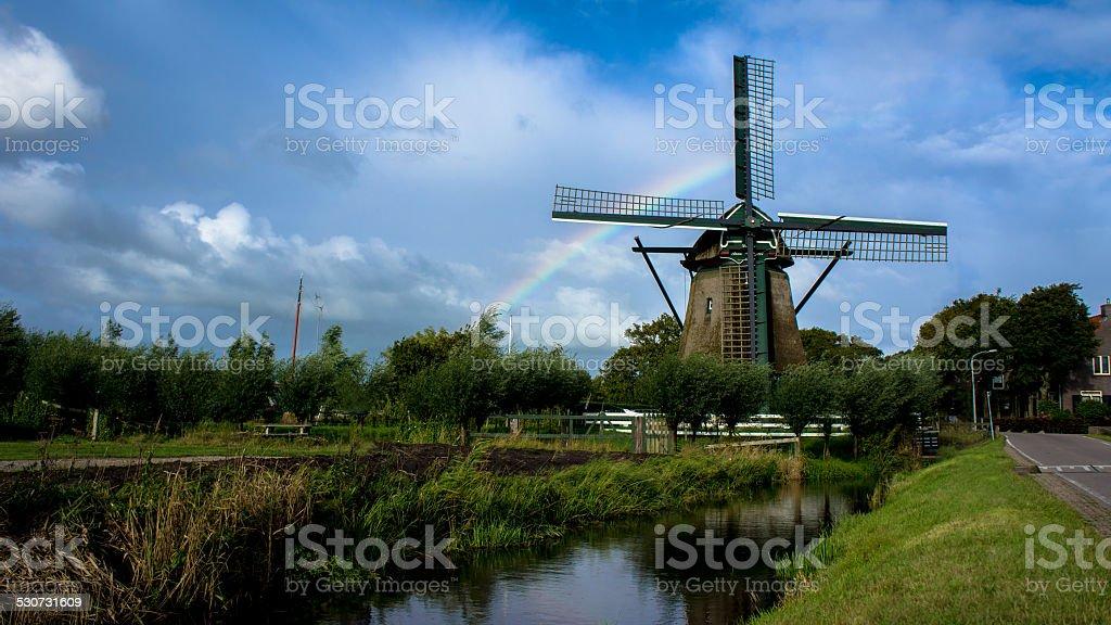Windmill De Veer with rainbow stock photo