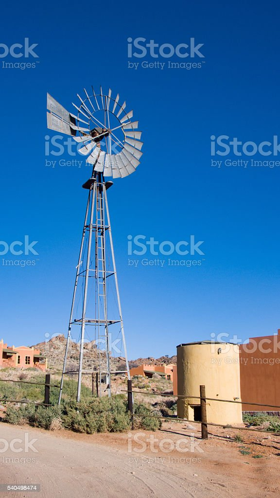 Windmill for water pumping stock photo