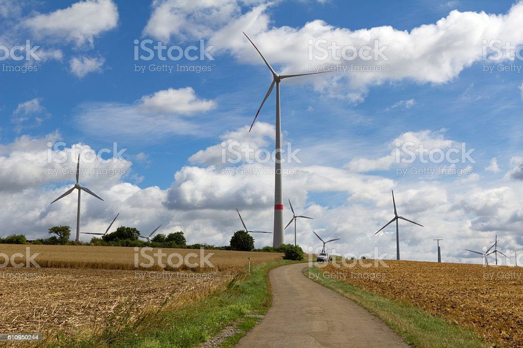 Windmill generator in wide yard stock photo