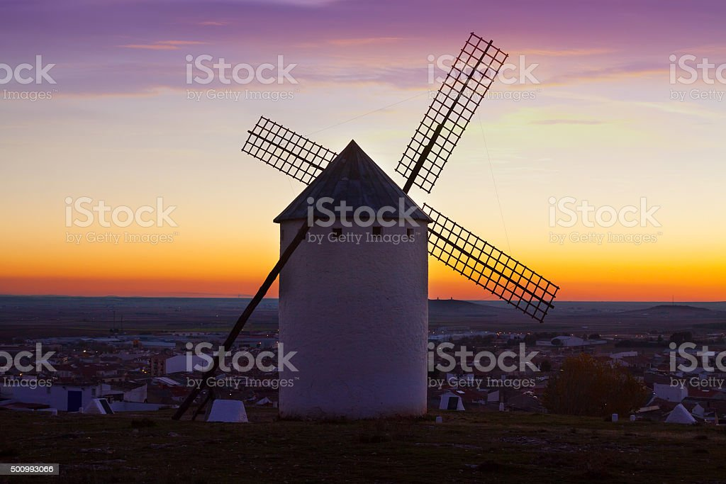 windmill in Campo de Criptana in sunrise time stock photo