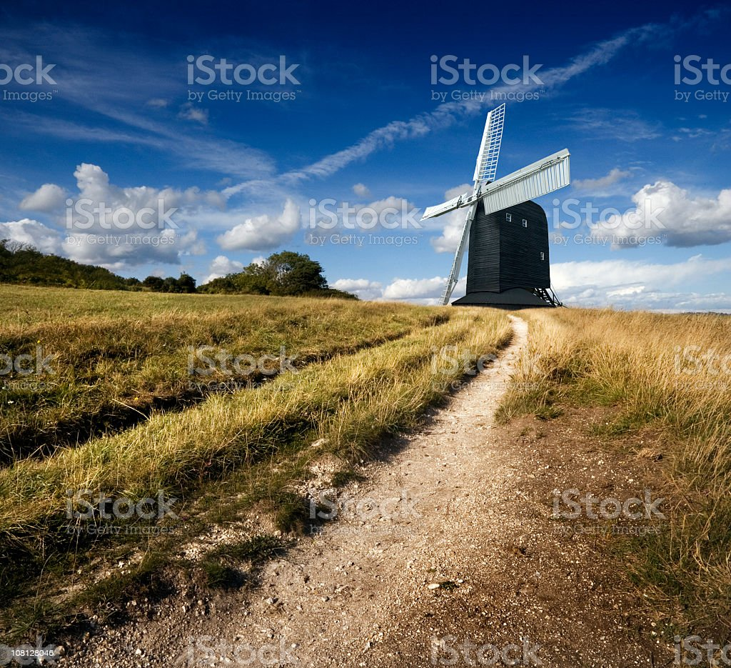Windmill in English Countryside on Top of Hill stock photo