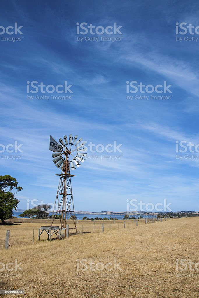 windmill in fresh green field royalty-free stock photo