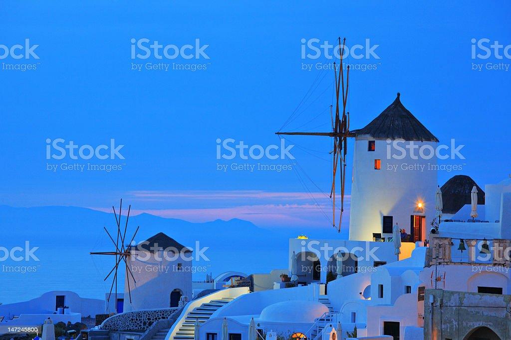 Windmill in Oia village on Santorini island royalty-free stock photo