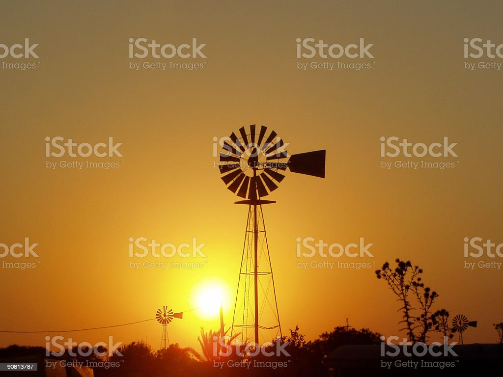 Windmill in sunset royalty-free stock photo