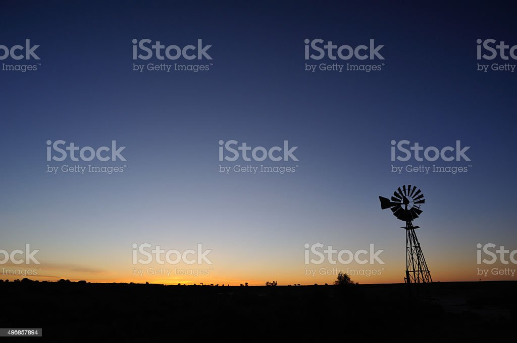 Windmill in the sunset stock photo