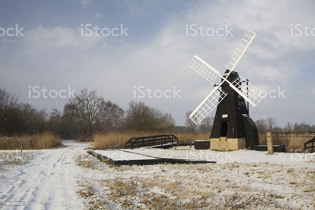 Windmill in winter snow royalty-free stock photo