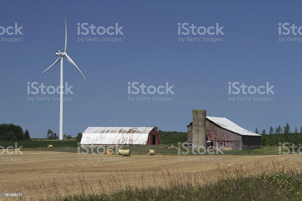 Windmill near farm barns. Wind Turbine Electricity Power Generator. Michigan. stock photo