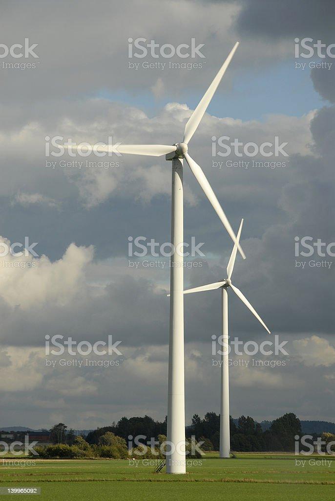 Windmill on field stock photo