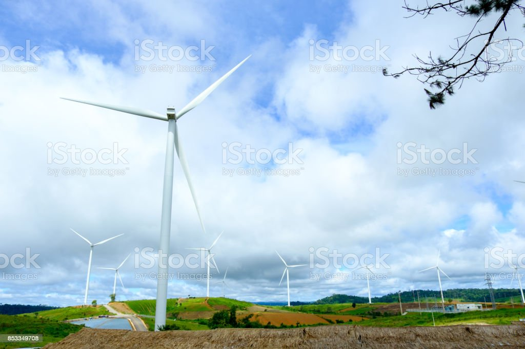 Windmill or turbine for electrical generator with nice blue sky from Thailand stock photo