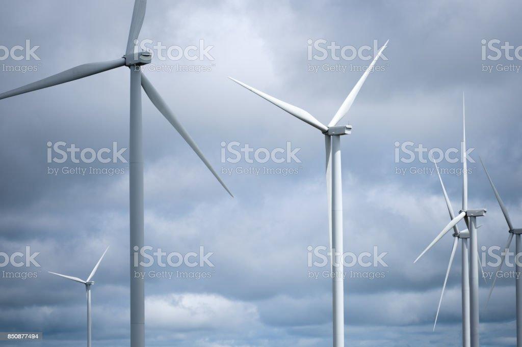 Windmill or turbine for electrical generator with overcast sky from Khao Kho, Phetchabun stock photo