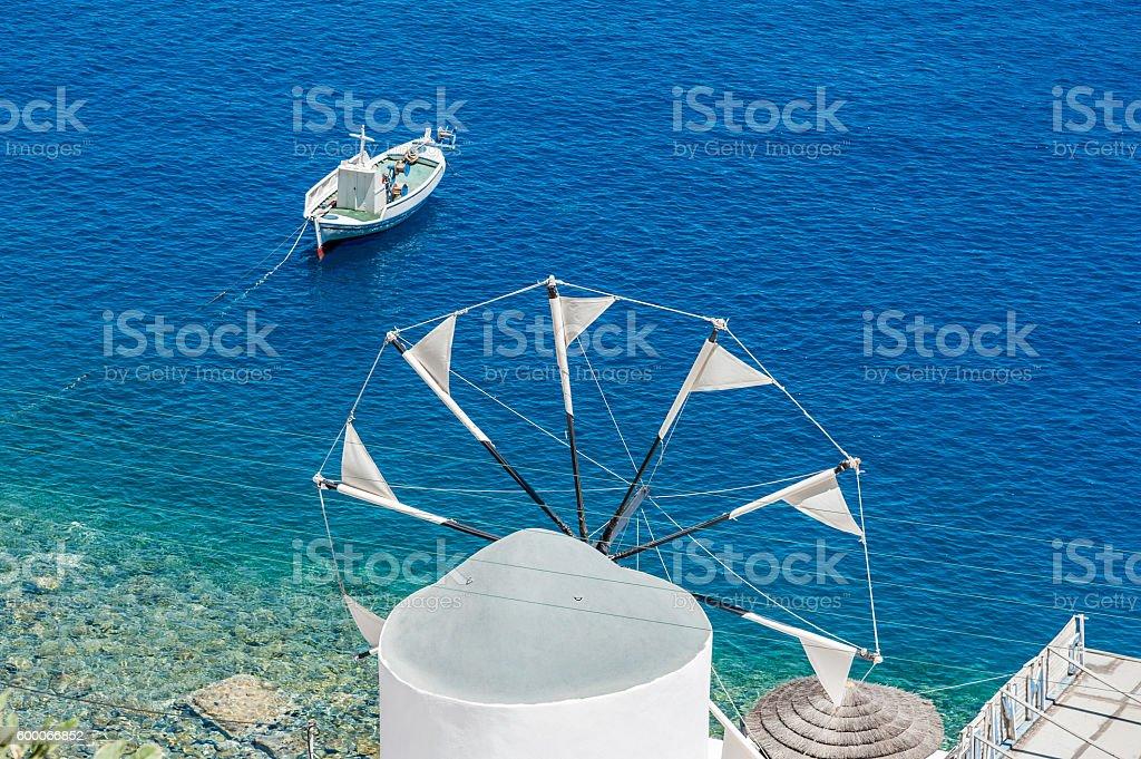 Windmill over the sea in Santorini stock photo