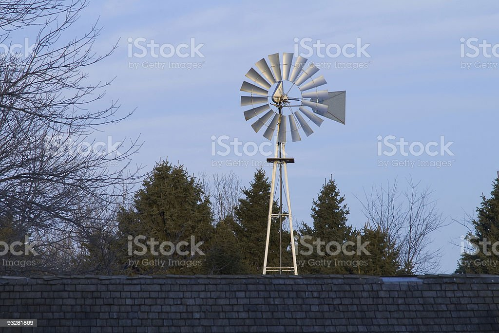 A windmill producing alternative energy royalty-free stock photo