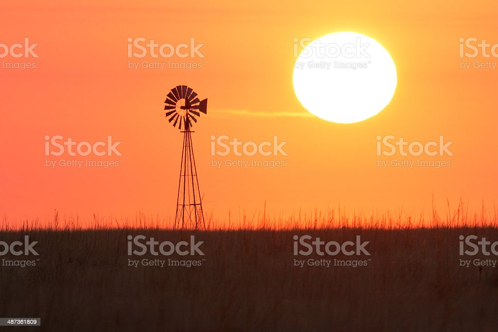 Windmill sunrise Cimarron National Grasslands Kansas royalty-free stock photo