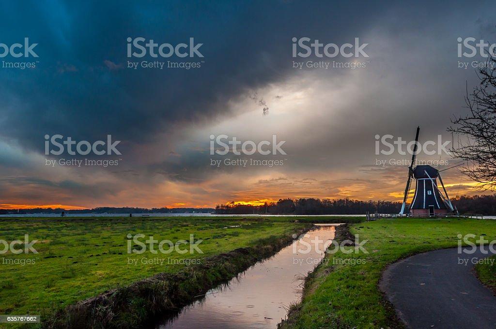 Windmill with a impressive sky stock photo