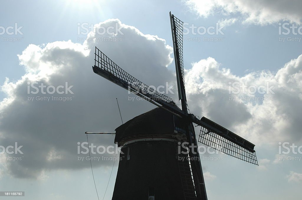 Windmill with cloudy sky royalty-free stock photo
