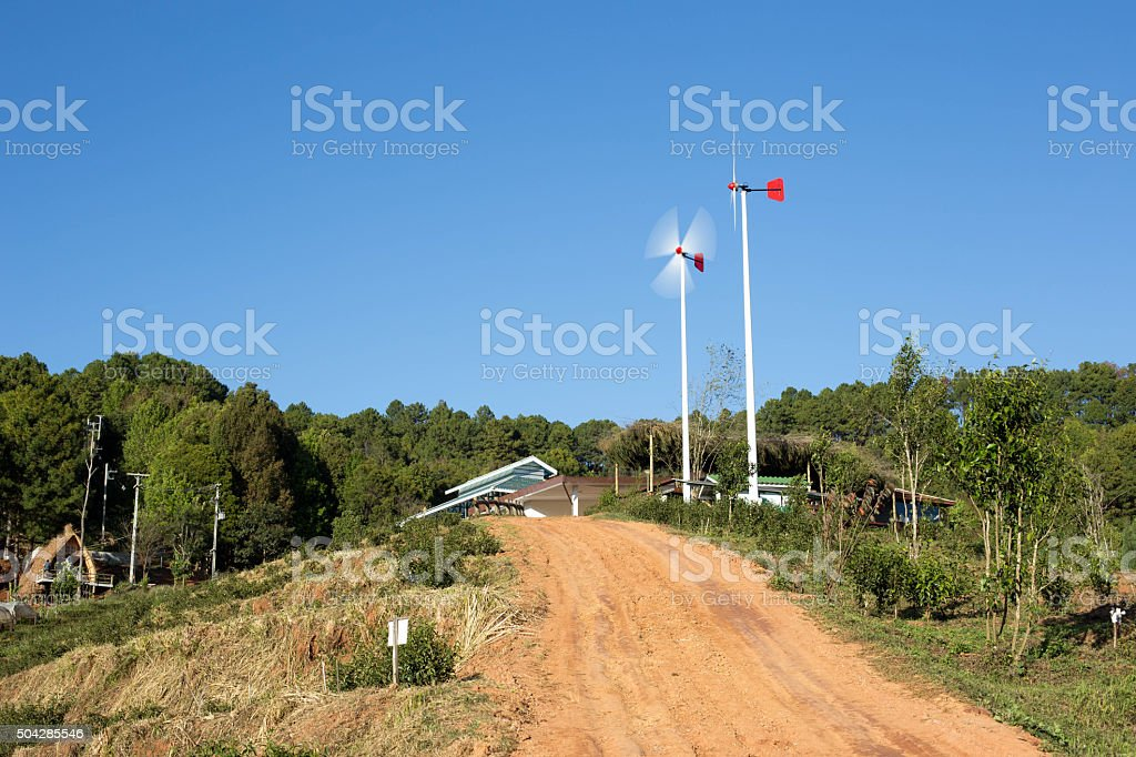 Windmills along the contry road stock photo