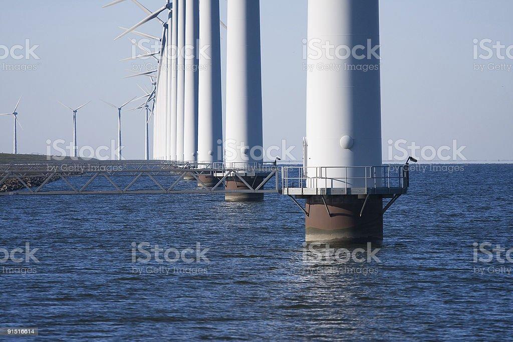 Windmills along the dike stock photo