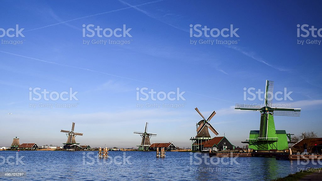 windmills along the river in the Netherlands stock photo