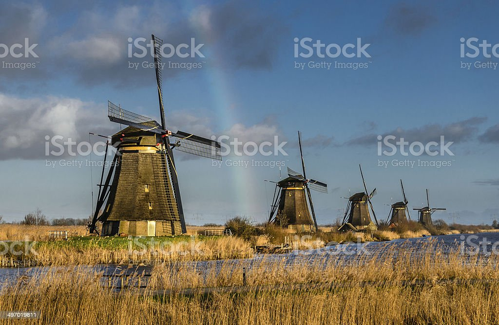 Windmills and Rainbow, Kinderdijk stock photo