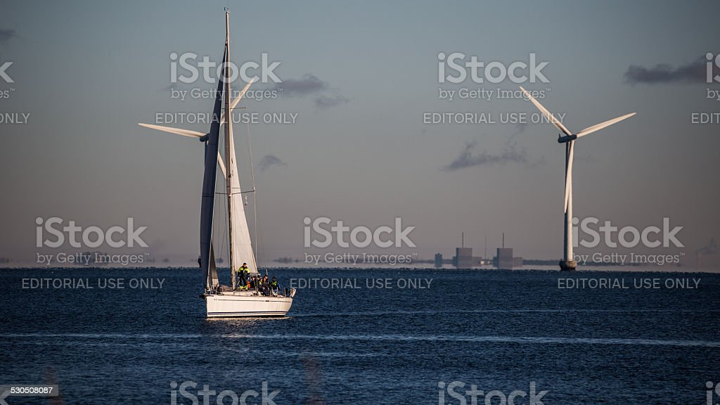 Windmills and sailing ships on Øresund, Denmark stock photo