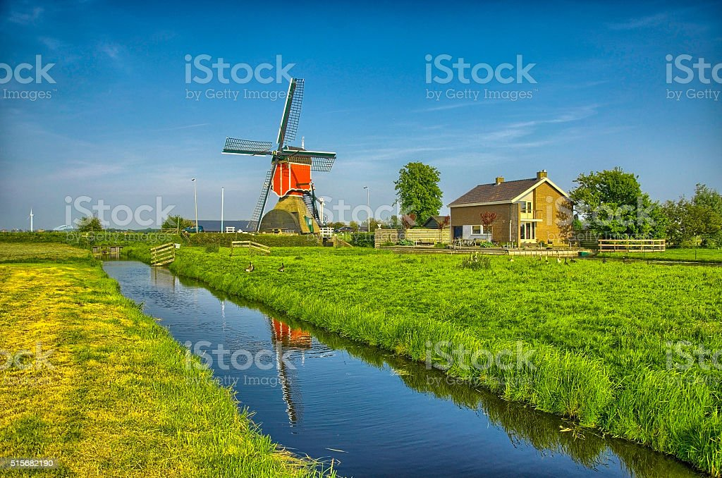 Windmills and water canal in Kinderdijk, Holland or Netherlands stock photo