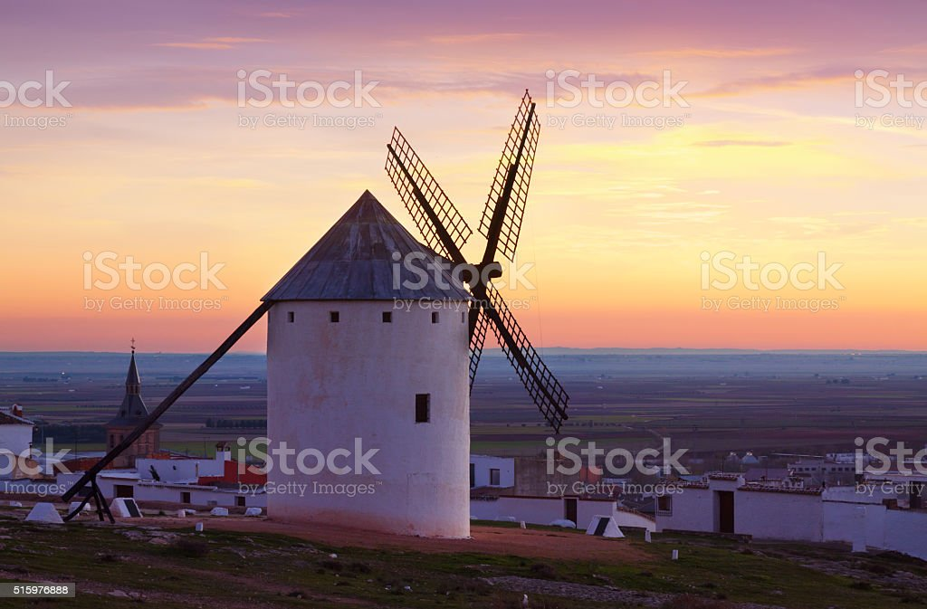 windmills at field in twilight. La Mancha stock photo