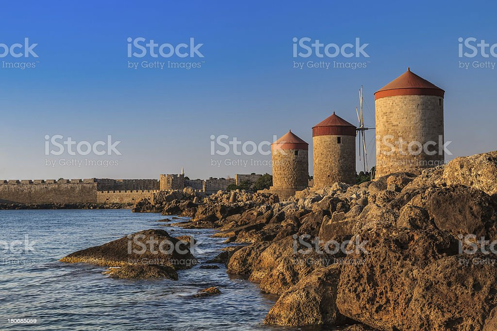 windmills at Rhodes Greece stock photo