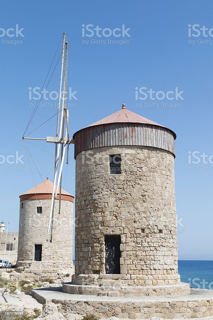 Windmills at Rhodes harbour, Greece royalty-free stock photo