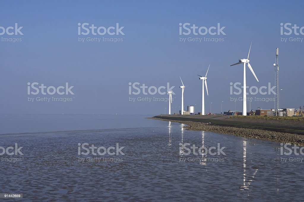 Windmills at seaside stock photo