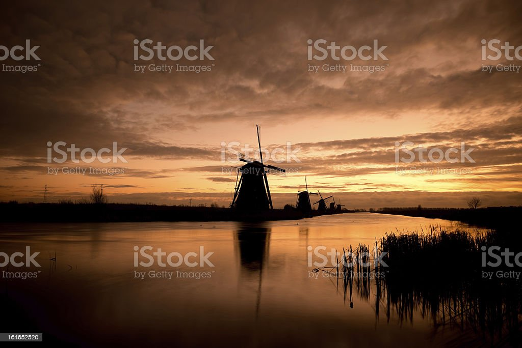 Windmills at sunrise royalty-free stock photo