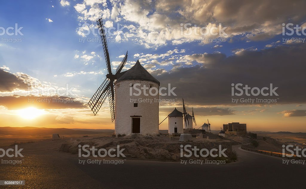 Windmills at sunset, Consuegra, Castile-La Mancha, Spain stock photo