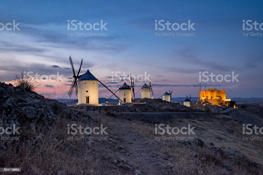 Windmills at the night in Consuegra town in Spain stock photo