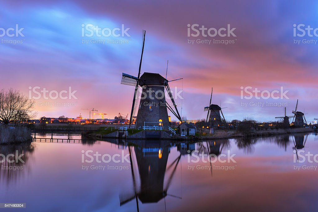 Windmills at  twilight after sunset in the famous kinderdijk, Netherlands stock photo