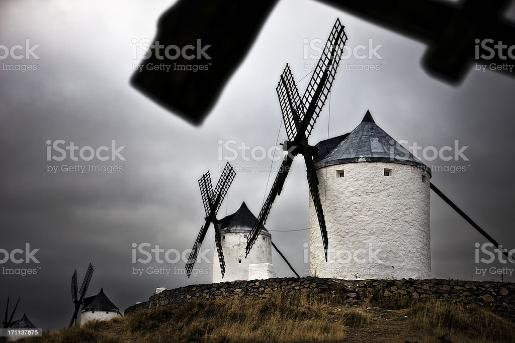 Windmills during a storm in Spain stock photo