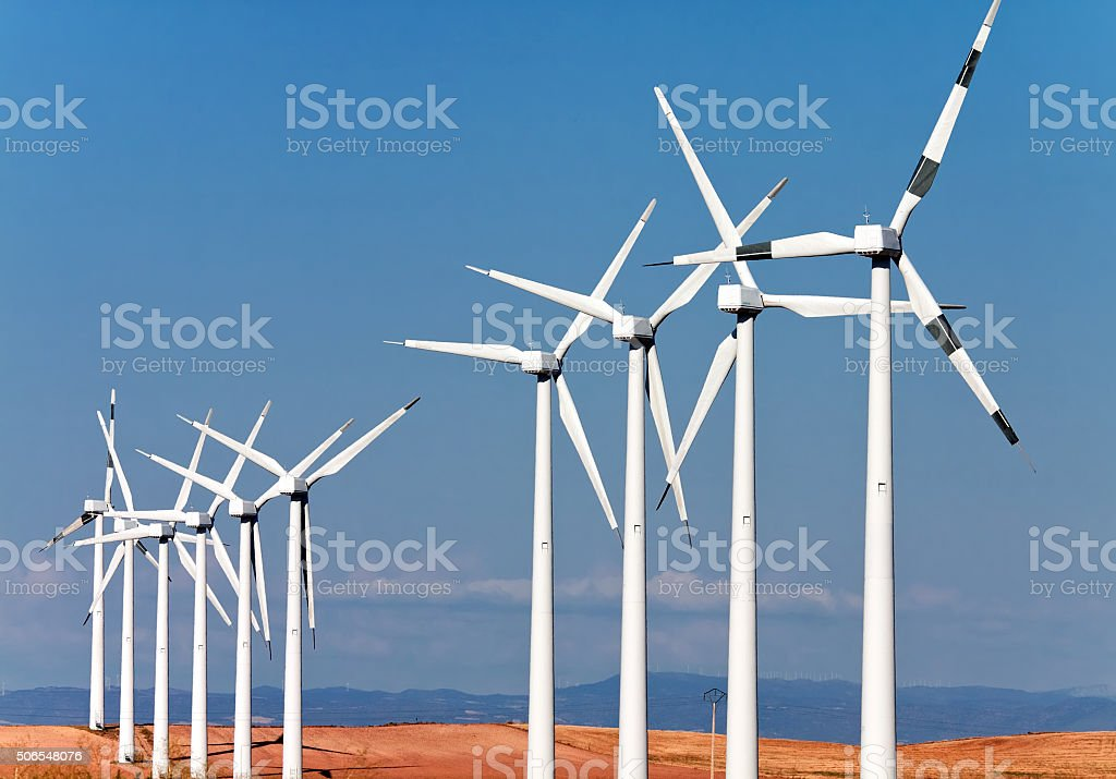 windmills for electric power production stock photo