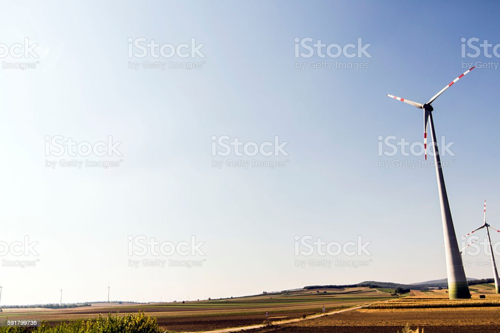 Windmills generating clean electricity stock photo