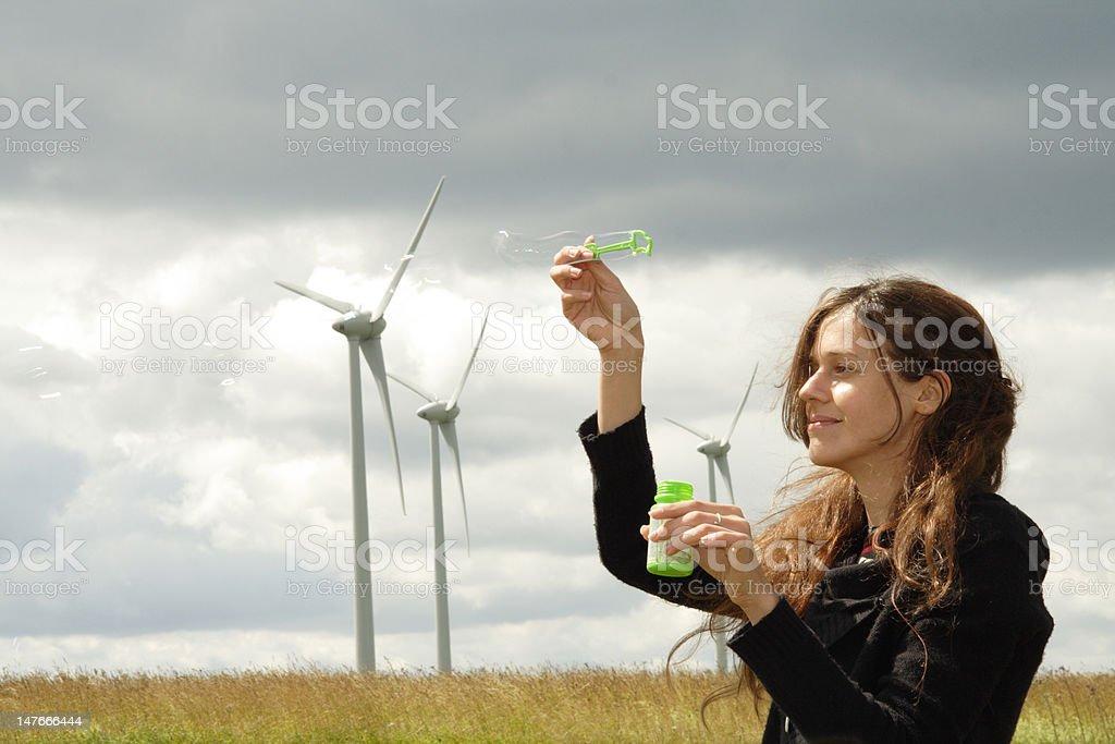 Windmills girl & soap bubbles stock photo