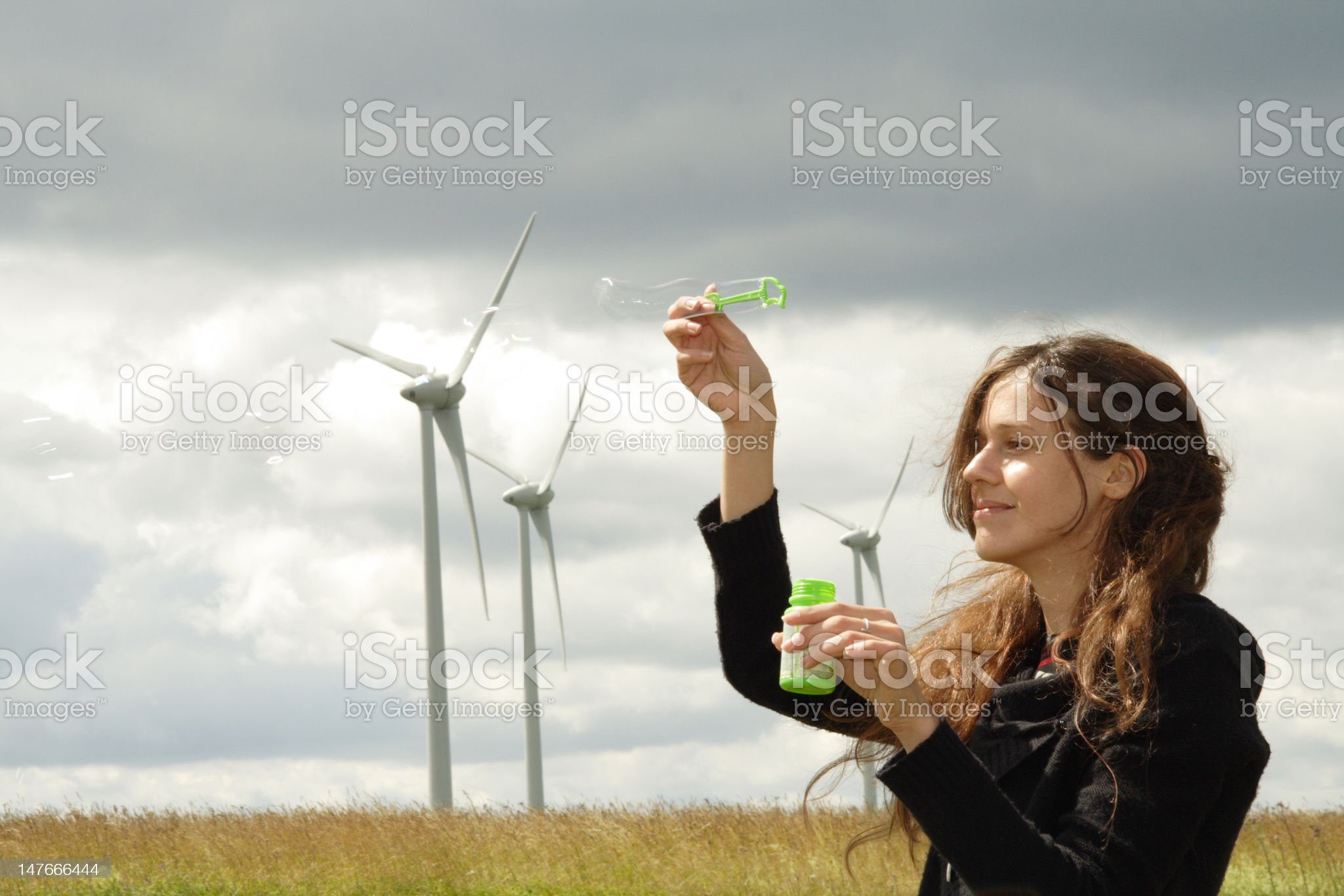 Windmills girl & soap bubbles royalty-free stock photo